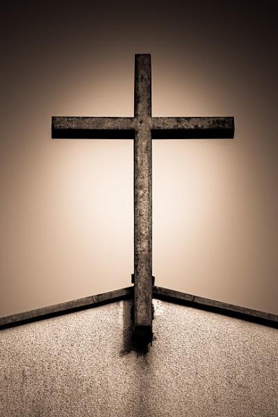 Old rusty metal cross in church by rninov