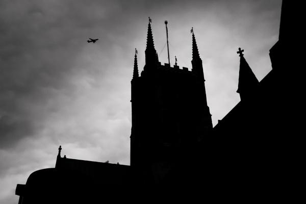 Plane over church by bobbyl