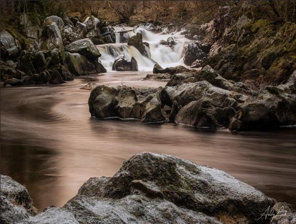 Golden Flow at Rumbling Bridge by andylock