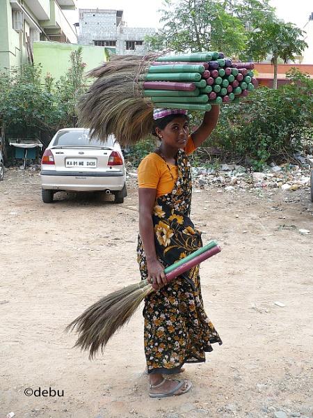 Saleswoman selling broom..2 by debu