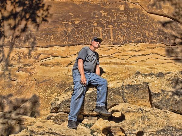 Man with petroglyphs by jbsaladino