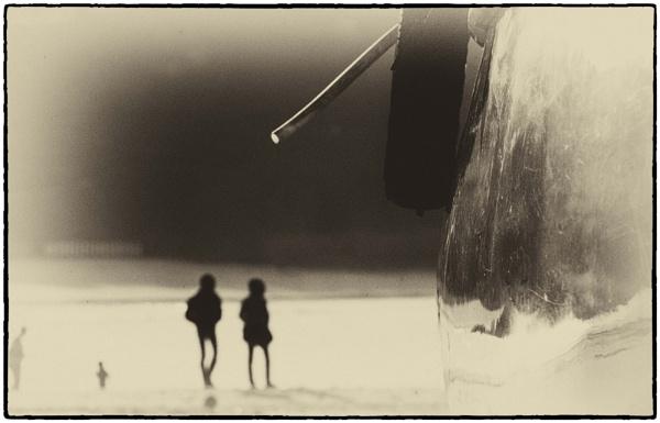 figures on a beach by bornstupix2