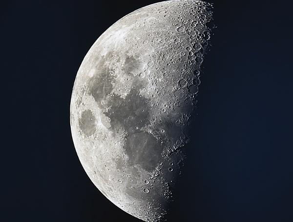 Moon through my telescope. by Brennan