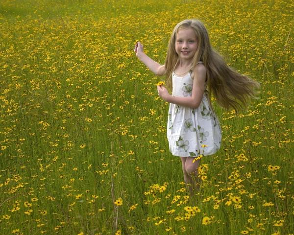 Gianna in a field of wildflowers by jbsaladino