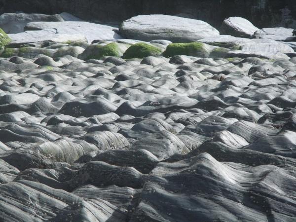 Rocks at Rockham Beach Devon by topcatj