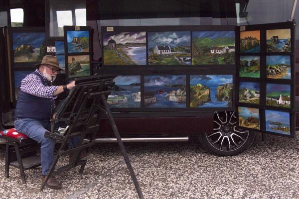 Artist in Ballingtoy Bay, Ireland by yultony
