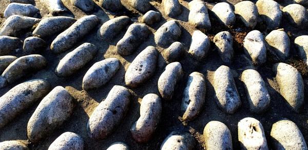 Pebbles and shadows... by Chinga