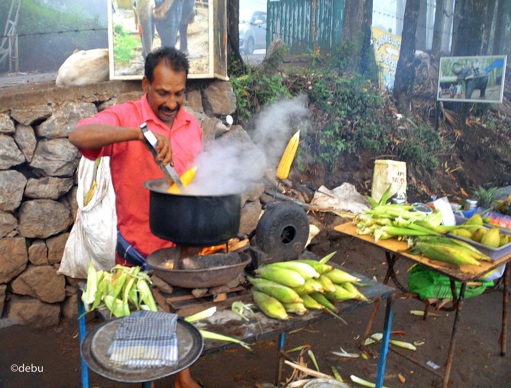 A poor street vendor in india selling corns