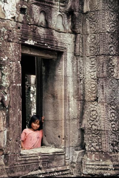 Girl at a window. Awesome Angkor, Cambodia by chrisdunham