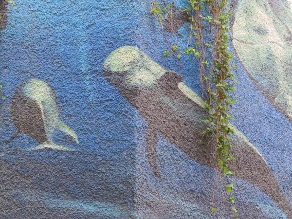 Faded overgrown mural by ddolfelin