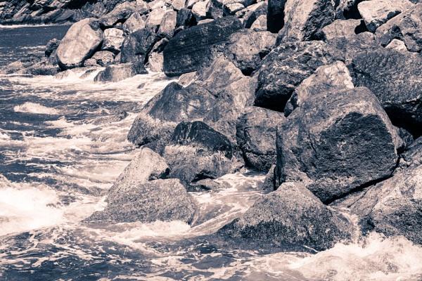 Waves on rocks on the sea by rninov