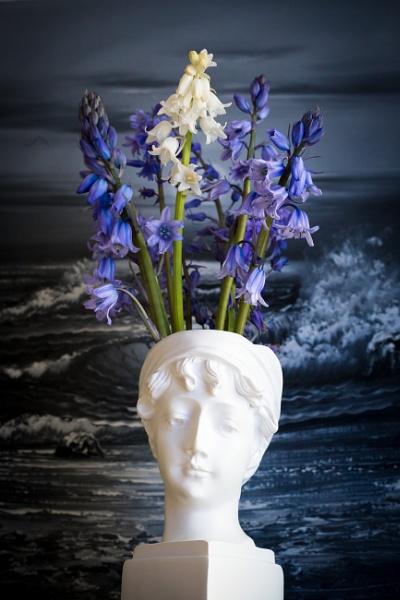 Bluebells in a white vase by JackAllTog