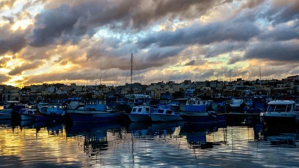 Sunset On Marsaxlokk by Xandru