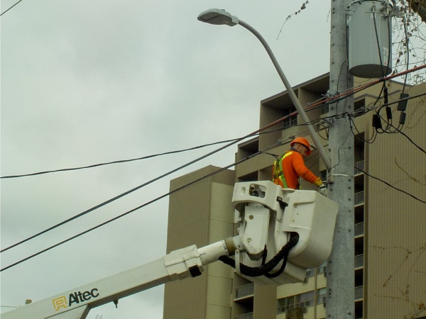 a CLOSER LOOK of WORKING ON STREET LAMP ON CHARLTON AVE W in DOWNTOWN HAMILTON on the MORNING of the 30TH APRIL 2021 by TimothyDMorton