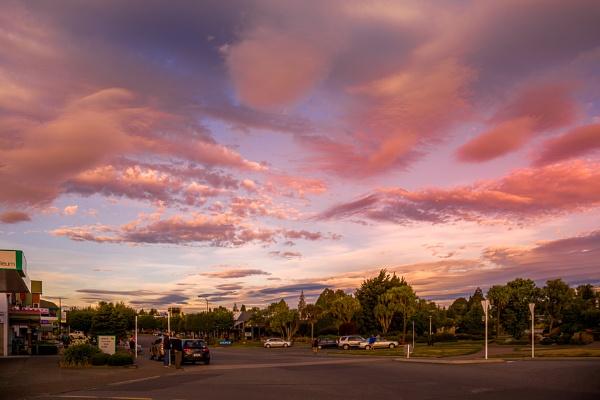 TE ANAU, FIORDLAND, NEW ZEALAND - FEBRUARY 17 : Admiring the Evening Sky at Te Anau, Fiordland, New Zealand on February 17, 2012. Unidentified people by Phil_Bird