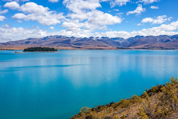 Scenic view of colourful Lake Tekapo in New Zealand by Phil_Bird