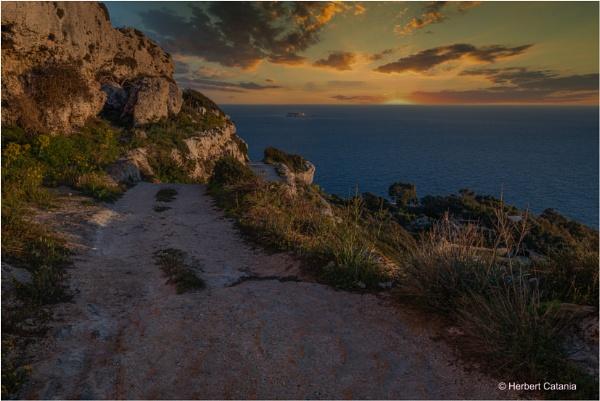 Sunset - Filfla Island by Herbert_Catania