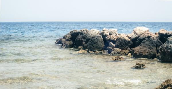 Rocks on the sea and empty sky by rninov