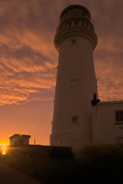 Lighthouse & Sun 1 by Alan_Baseley