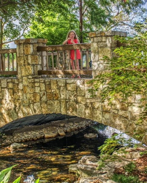 Girl on a bridge by jbsaladino