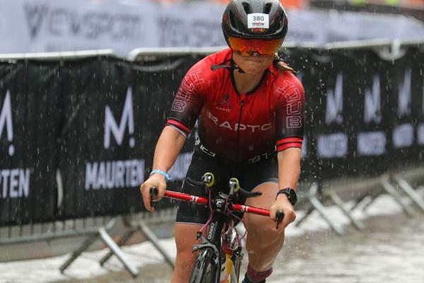 Triathlon cyclist battered by rain by philtaylorphoto