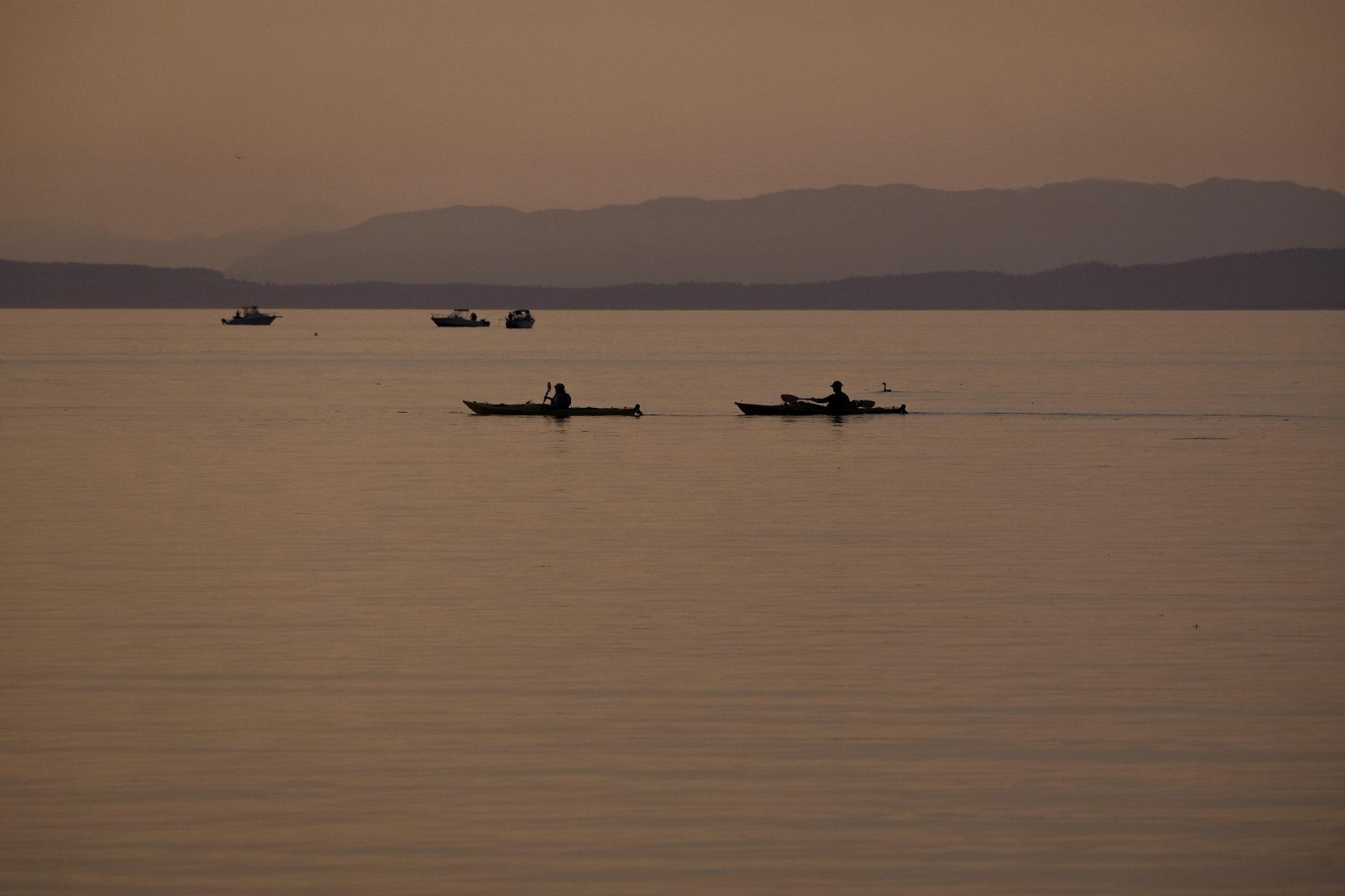Kayakers and Fishermen