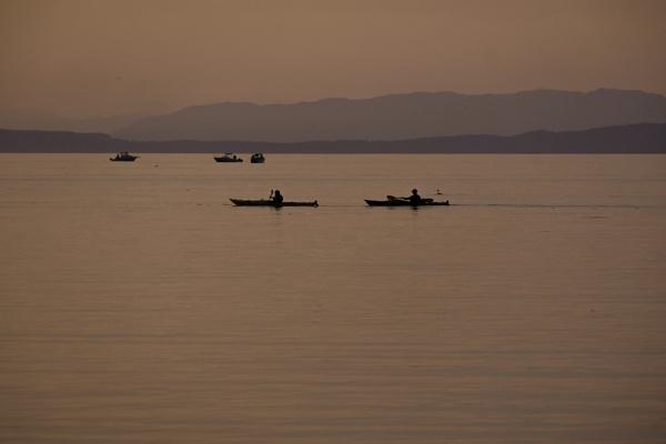 Kayakers and Fishermen by Daisymaye