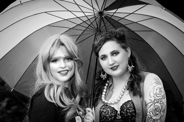Sarah and Rachel under the umbrella in B&W by JackAllTog