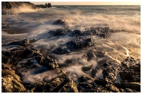 L Etacq Waves at Sunset by happysnapper