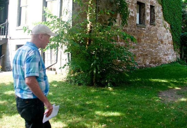 Bill King leading a tour the back side of MacNab Presbyterian Church in Hamilton by TimothyDMorton