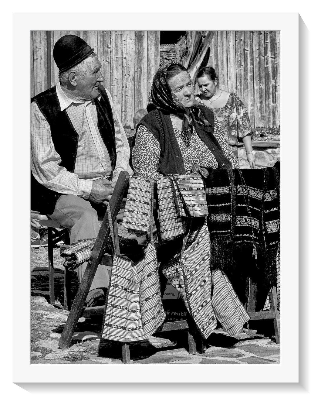 Elderly Romanian couple at local food festival