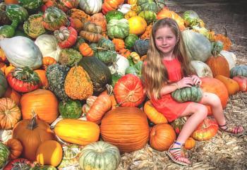 Girl wit pumpkins