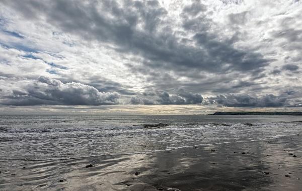 Clouds at Clonea Strand by DicksPics