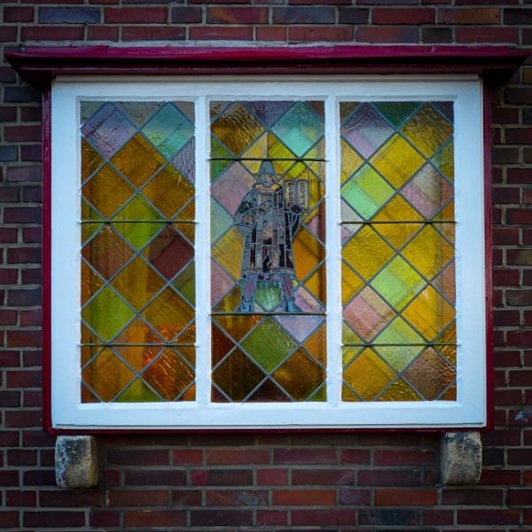 Colorful window and brick wall by rninov