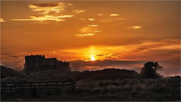 Bamburgh Castle Sunset by dven