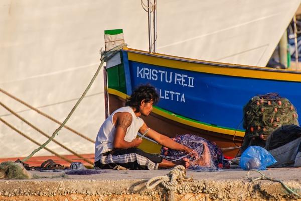 Repairing The Fishing Nets by Xandru