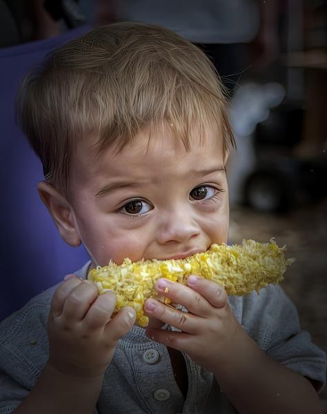 Enjoying corn on the cob by jbsaladino